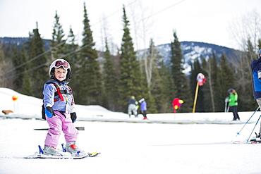 Little girl (2-3) learning skiing , USA, Montana, Whitefish