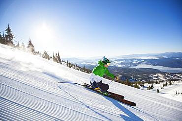Mature man on ski slope at sunlight, USA, Montana, Whitefish