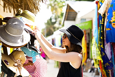Woman looking at hats, Dominican Republic