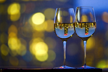 Two wineglasses with white wine, USA, New York, New York City