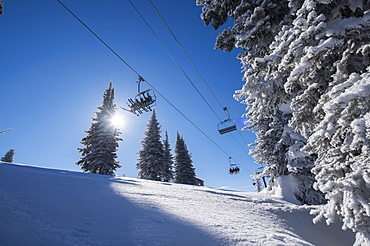 Ski lift over ski slope, USA, Montana, Whitefish