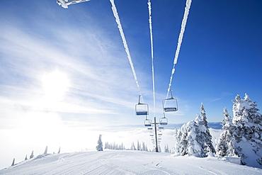 Ski lift at sunlight against blue ski, USA, Montana, Whitefish