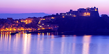 Italy, Campania, Naples, Panorama of Procida Island at sunrise