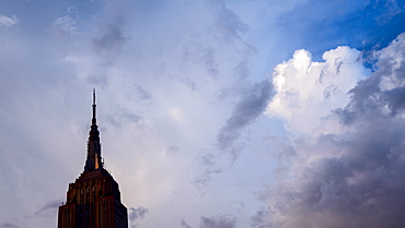 USA, New York, New York City, Empire State Building against clouds