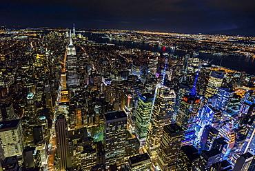 USA, New York, New York City, Manhattan, Aerial view of illuminated skyline at night