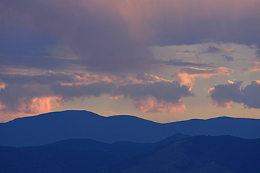 USA, Colorado, Denver, Colorful evening sky over mountain range