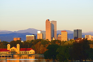 USA, Colorado, Denver, City Park with buildings in background at dawn