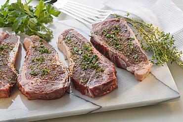Seasoned pieces of meat on platter