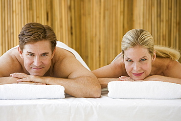 Couple on spa treatment tables