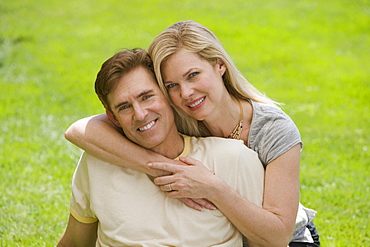 Couple hugging in grass