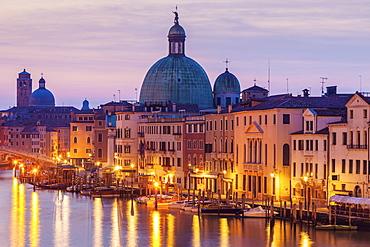 Italy, Veneto, Venice, Street light reflecting in water with Dome of Santa Maria della Salute Basilica