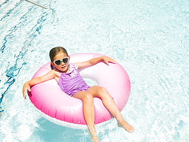 Girl (4-5) relaxing in inflatable ring