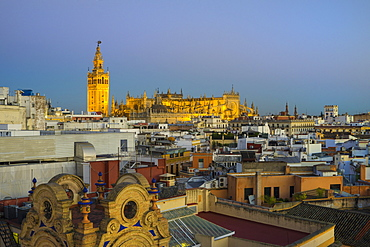 Spain, Seville, Cityscape with Cathedral of Seville at sunset