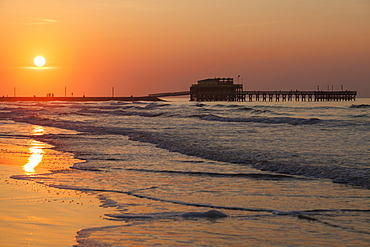 Beach and pier at sunset in Galveston, Texas, Galveston, Texas, USA
