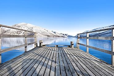 Pier on lake in Tromso, Norway