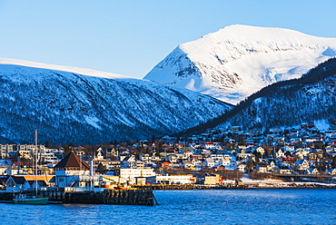 Town under snow covered mountains in Tromso, Norway