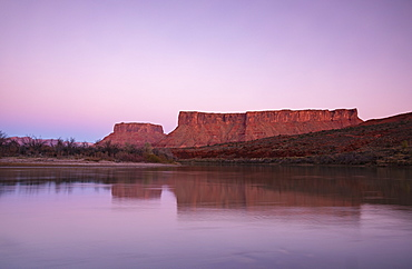 Cliffs by Colorado River at sunset in Utah, USA
