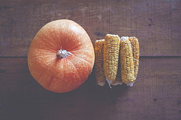 Pumpkin and corn cobs