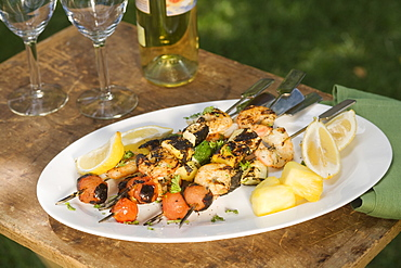 Grilled shish kebab on platter