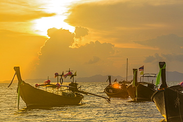 Boats at sunset in West Railay, Thailand