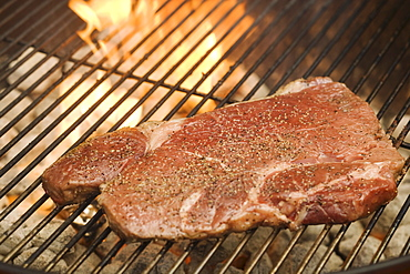 Steak cooking on grill