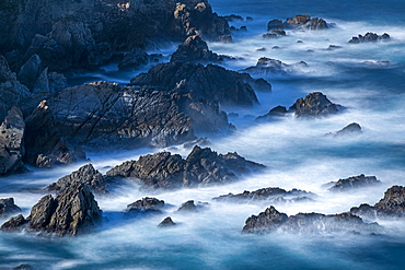 Long exposure shot of rocks in sea at Carmel-by-the-Sea, California, USA