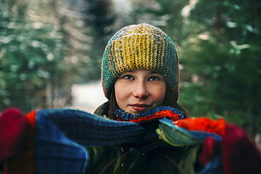 Teenage girl with colorful woollen hat and scarf during winter