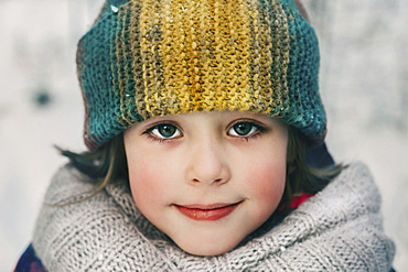 Girl in woollen hat during winter