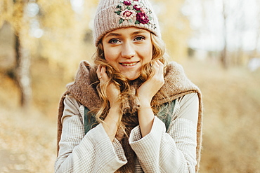 Young woman in floral pattern woolen hat