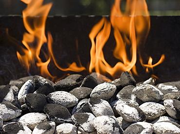 Close up of charcoal briquette fire