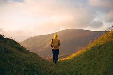 Rear view of man hiking in the Carpathian Mountain Range