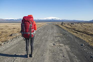 Hiker on road in Fjallabak Nature Reserve in Iceland