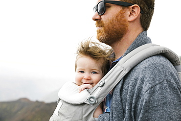 Father with his baby girl in baby carrier