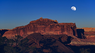 Moon over rock formation in Capitol Reef National Park, USA