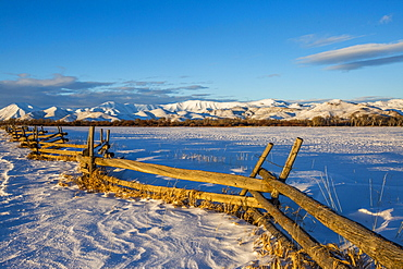 Wooden fence and snow field in Picabo, Idaho