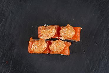 Salmon sushi with orange sauce