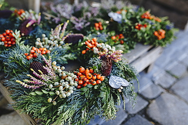 Christmas wreaths on pallet