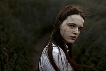 Portrait of windswept teenage girl