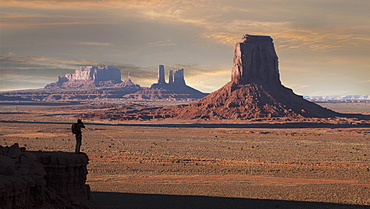 Silhouette of man photographing Monument Valley Navajo Tribal Park, USA