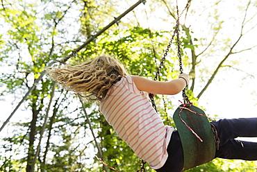 Girl wearing striped t-shirt on swing