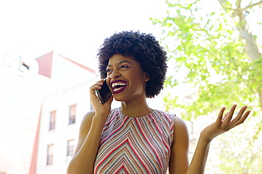 Smiling young woman on phone call