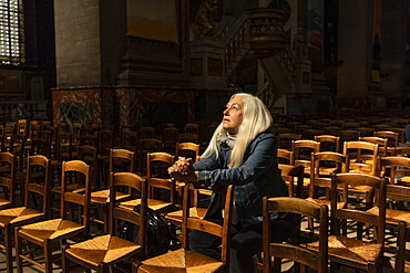 Mature woman sitting in church