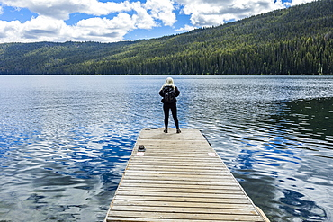 Woman standing on jetty on lake in Stanley, Idaho, USA