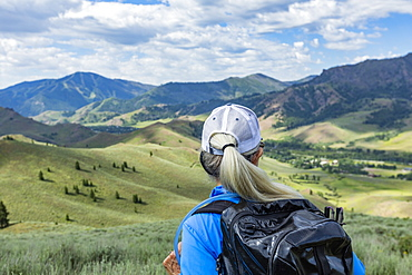 Rear view of mature woman hiking in Sun Valley, Idaho, USA