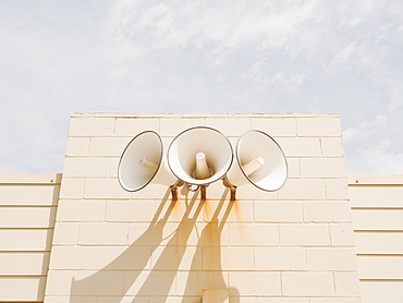 Three loudspeakers on wall