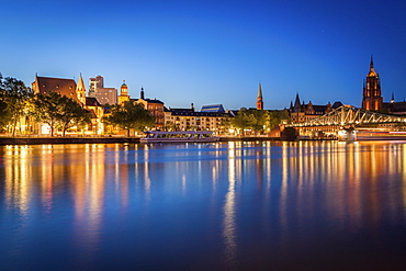 Buildings by river at sunset in Frankfurt, Germany