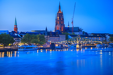 Cathedral by river at sunset in Frankfurt, Germany