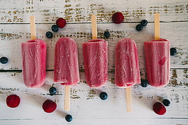 Row of berry ice pops with berries