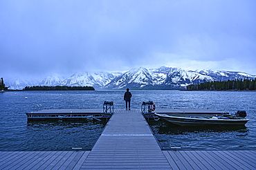 Woman standing on jetty on Jenny Lake in Grand Teton National Park, USA