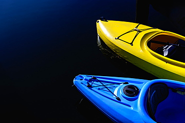 Yellow and blue kayaks on water